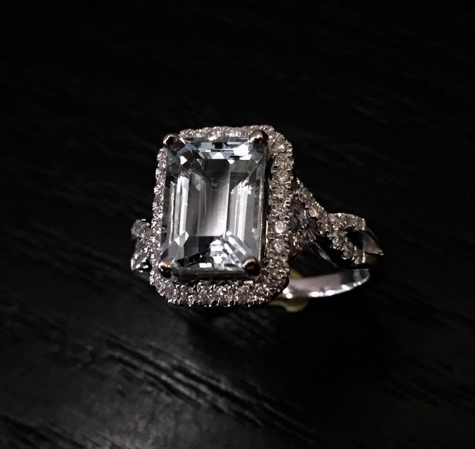 2.17 carat emerald cut Aquamarine set in a 18kt. white gold .33 carat diamond mounting..jpg