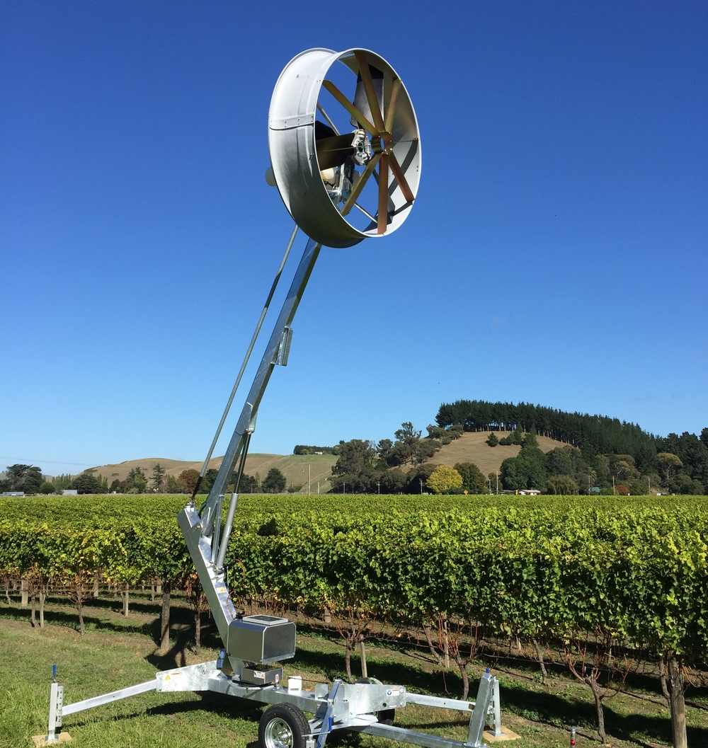 Tow and Blow wind machine blowing over an orchard