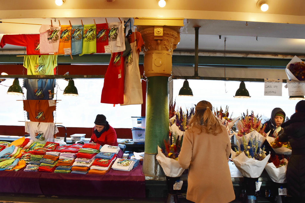 Booths and tables line the semi-outdoor market halls. Everything from seafood, flowers, and jewelry can be found at anyone of these private vendors shops.