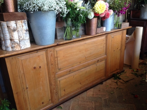 This is one of our amazing shop counters we made for  flowers at the farm  in Byron Bay. This counter is made from 100 year old Baltic pine European doors with a old rustic top. it has been finished in a heavy wearing oil then cut back with a dark wax to give the old look but be very practical at the same time.