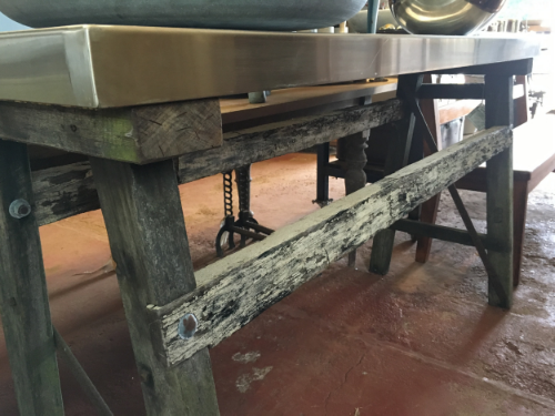 Here is one of our pieces that Paul has just finished making. It is an old original work bench base with a new stainless top. He chose this design to show how well old can be mixed with new.