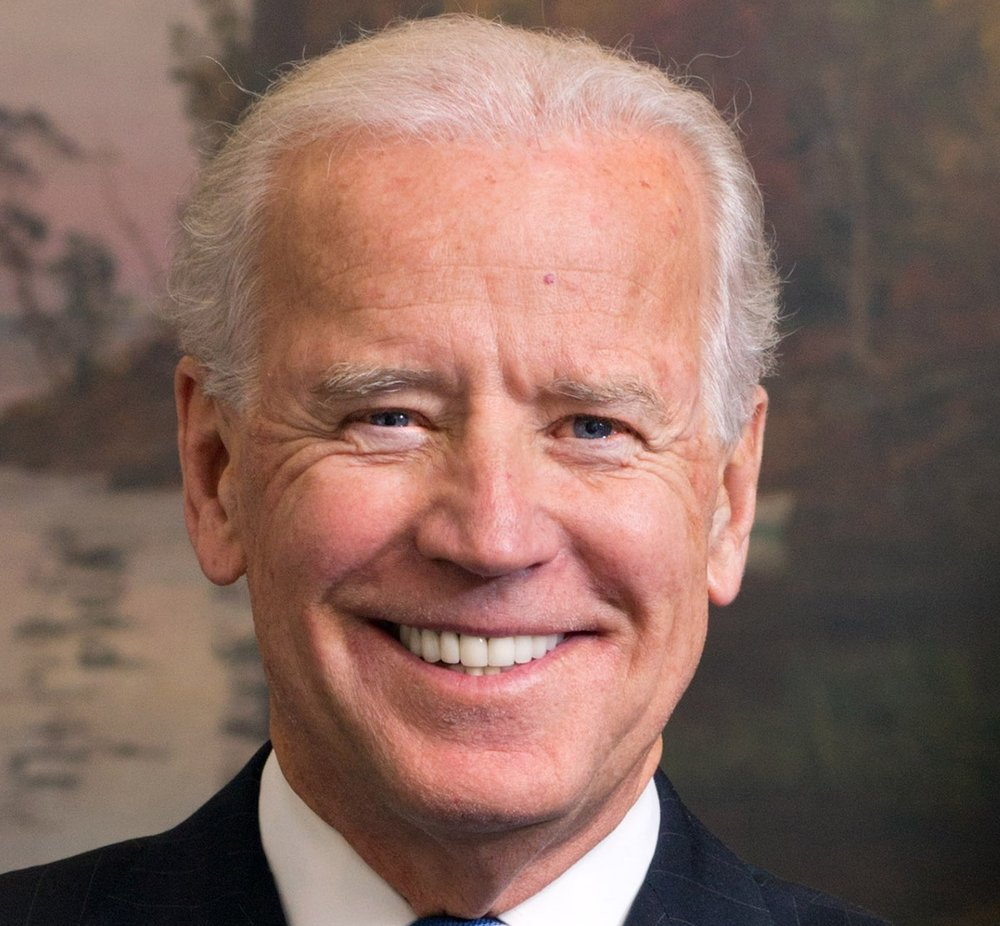 Image of Joe Biden smiling and displaying clearly visible dental crowns