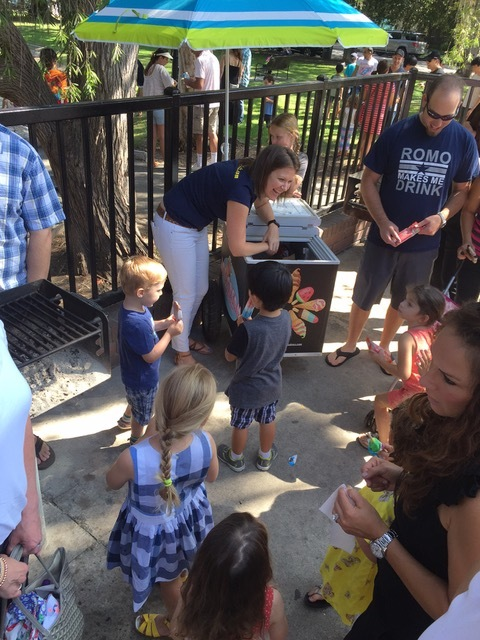 Mariana serving fruit bars and popsicles to excited kindergarten kids.
