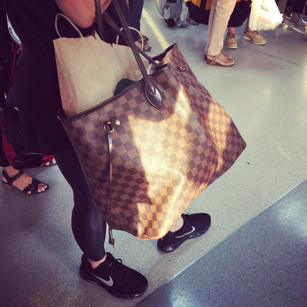 The Eben Damier Neverfull bag... In the wild and waiting to fly to San Diego.
