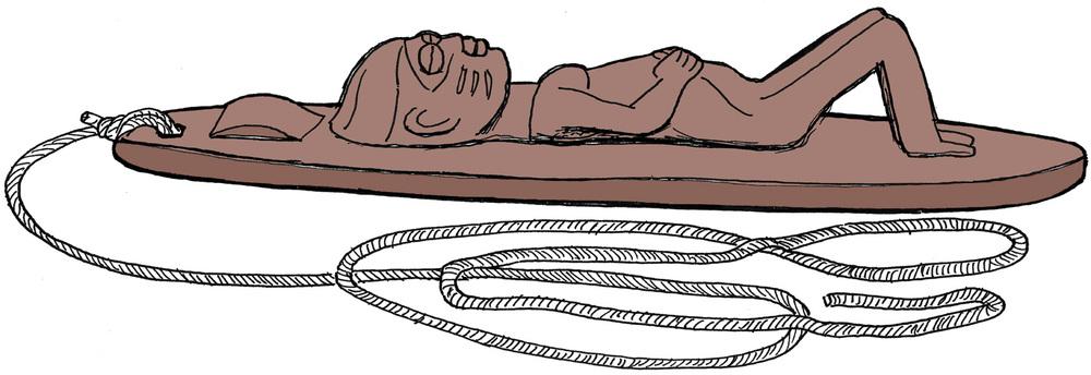 A Yoruba bullroarer with a figurative carving on top.