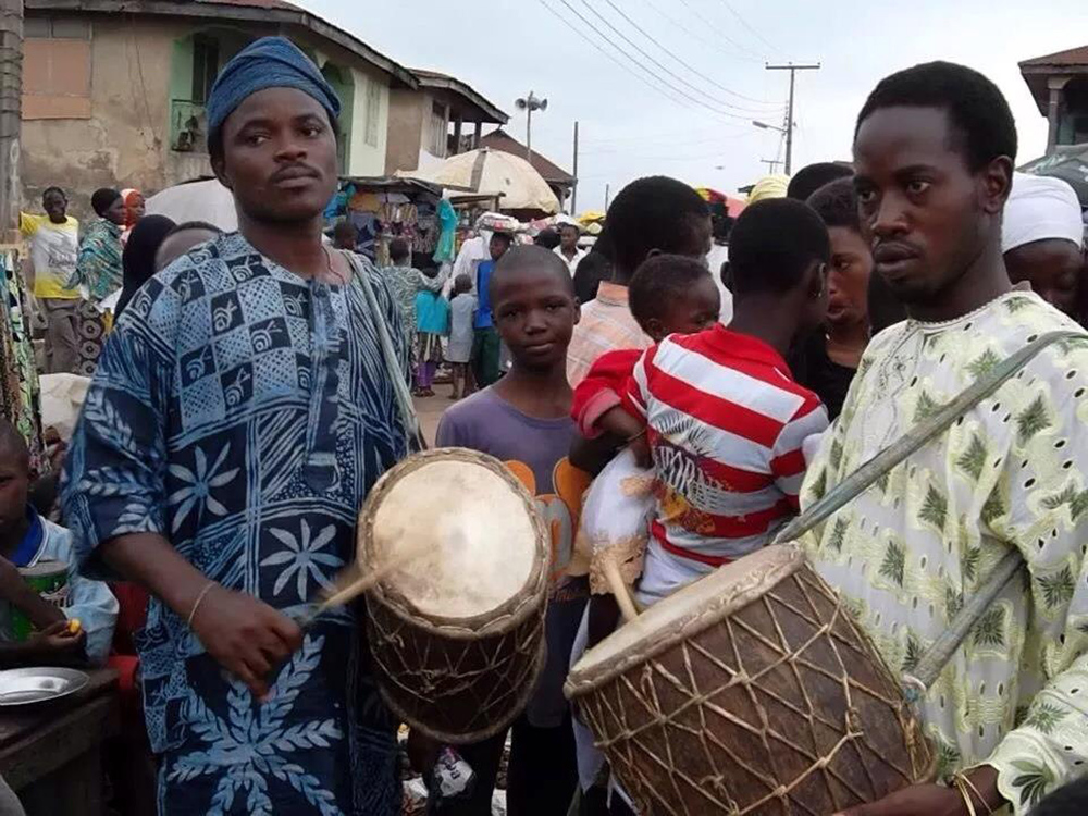 Sangosakin and Olaifa Akande playing Oshun's sacred bembe drums in Osogbo.
