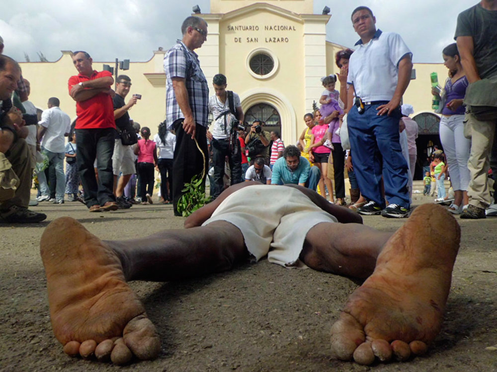 Once a year devotees of San Lazaro associated with Babaluaye make a ritual pilgrimage to his church in Havana, many of them lie down and drag themselves forward. Photo Walfrido Lopez Rodriguez CC BY-NC-ND 2.0