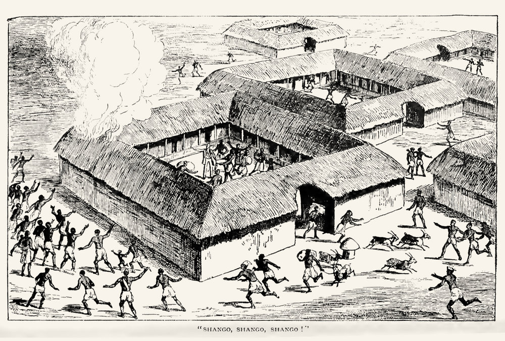 "An image showing the outbreak of fire, the subtitle says people are screaming ""Shango!"" In the middle of the compound there could be the missionary, pointing at the fire, he remains calm, explaining something in the midst of the turbulence."