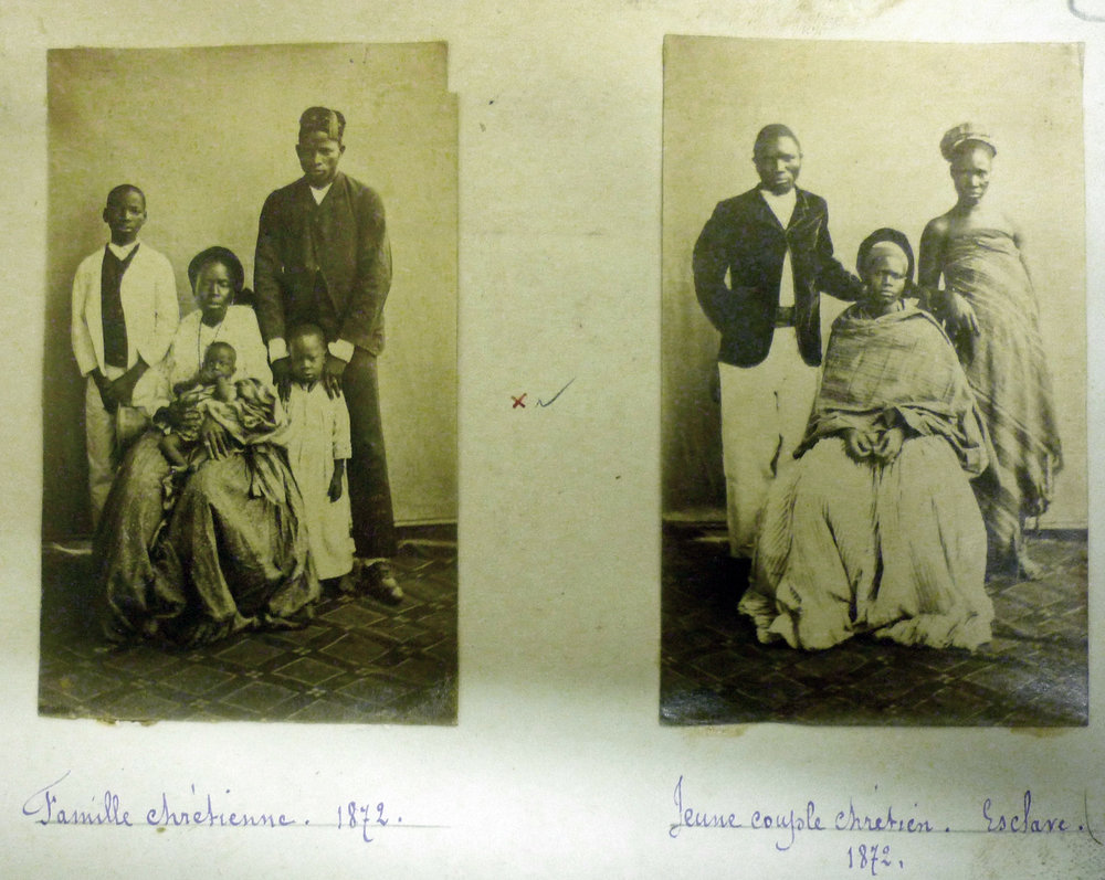 Two portraits of Àgùdà families, ca. 1870, location unidentified but probably Lagos. Note the Western attire, except for the woman at far right, identified as a slave. Source: SMA Archives, Rome, photo taken by Lisa Earl Castillo