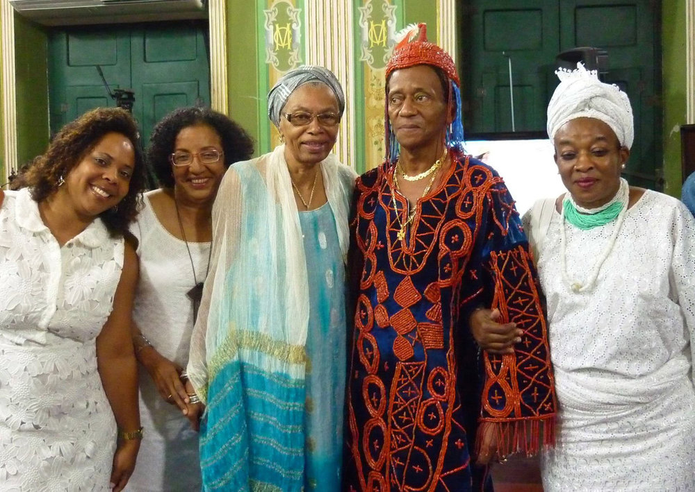 An image from the celebrations commemorating the 70th anniversary of the initiation of Erelu Lola Ayonrinde's Brazilian cousin, Babalorixá Air Jose Souza de Jesus, great-great grandson of Bamboxê. From left: two members of Ilê Axé Iyá Nassô Oká, Gerenice Brandão, a senior ekedi of the same temple, Babalorixá Air José, and Erelu. ©Lisa Earl Castillo