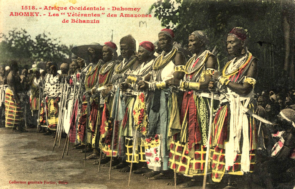 "A colored postcard showing female Dahomey war veterans, the ""Amazons"", 1918. Source:  Wikipedia . Image Public Domain."