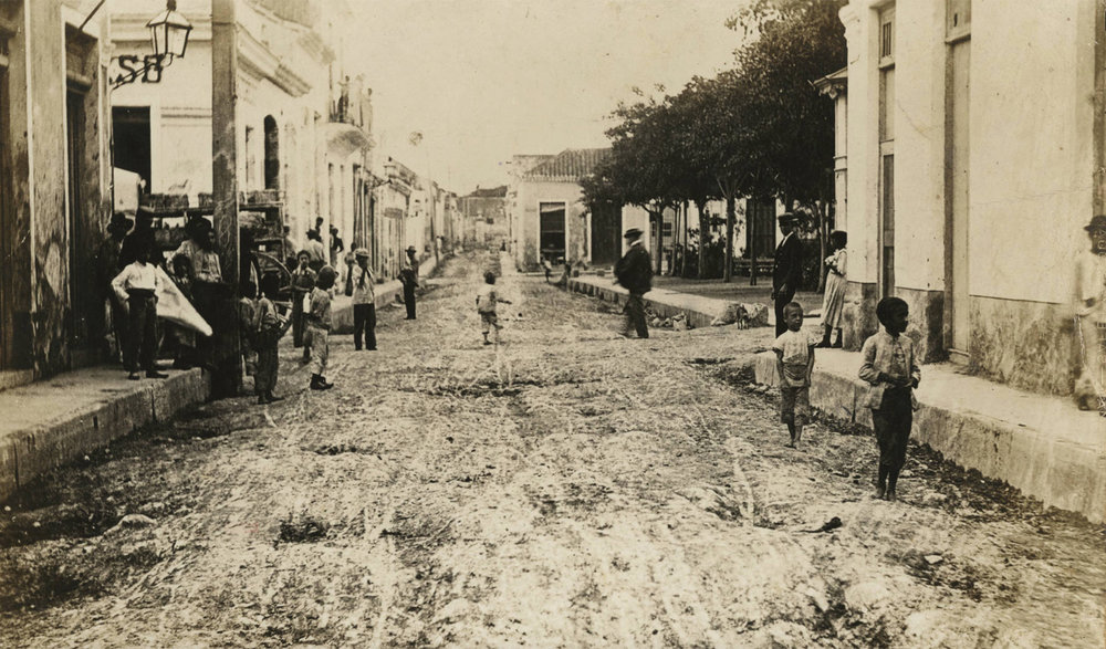 "Street view in Havana's city center, today called ""La Habana Vieja"", Calle Vives, 1899. Found in the Cuban Photograph Collection by the  University of Miami Libraries . Image Public Domain."