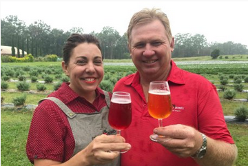 Kim and Jason Lewis with their berry 'no waste' cider.  Photo Credit: Jennifer Nichols, ABC Rural