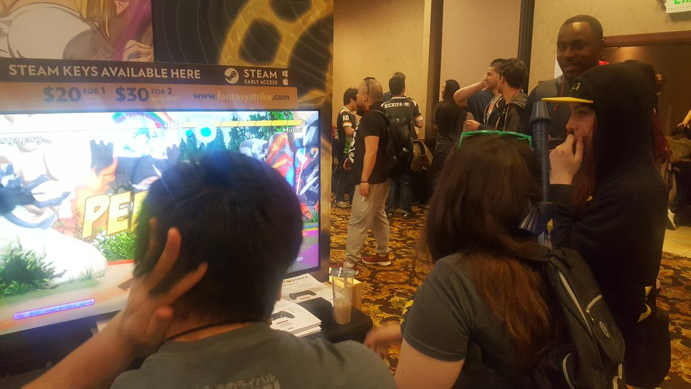 Snake Eyez  and  gllty  watch  eltrouble  (world-class ST Dhalsim) and  Killer Miller  (world-class ST Honda) explore the Argagarg vs. Midori matchup (bad quality photo taken from my phone :()