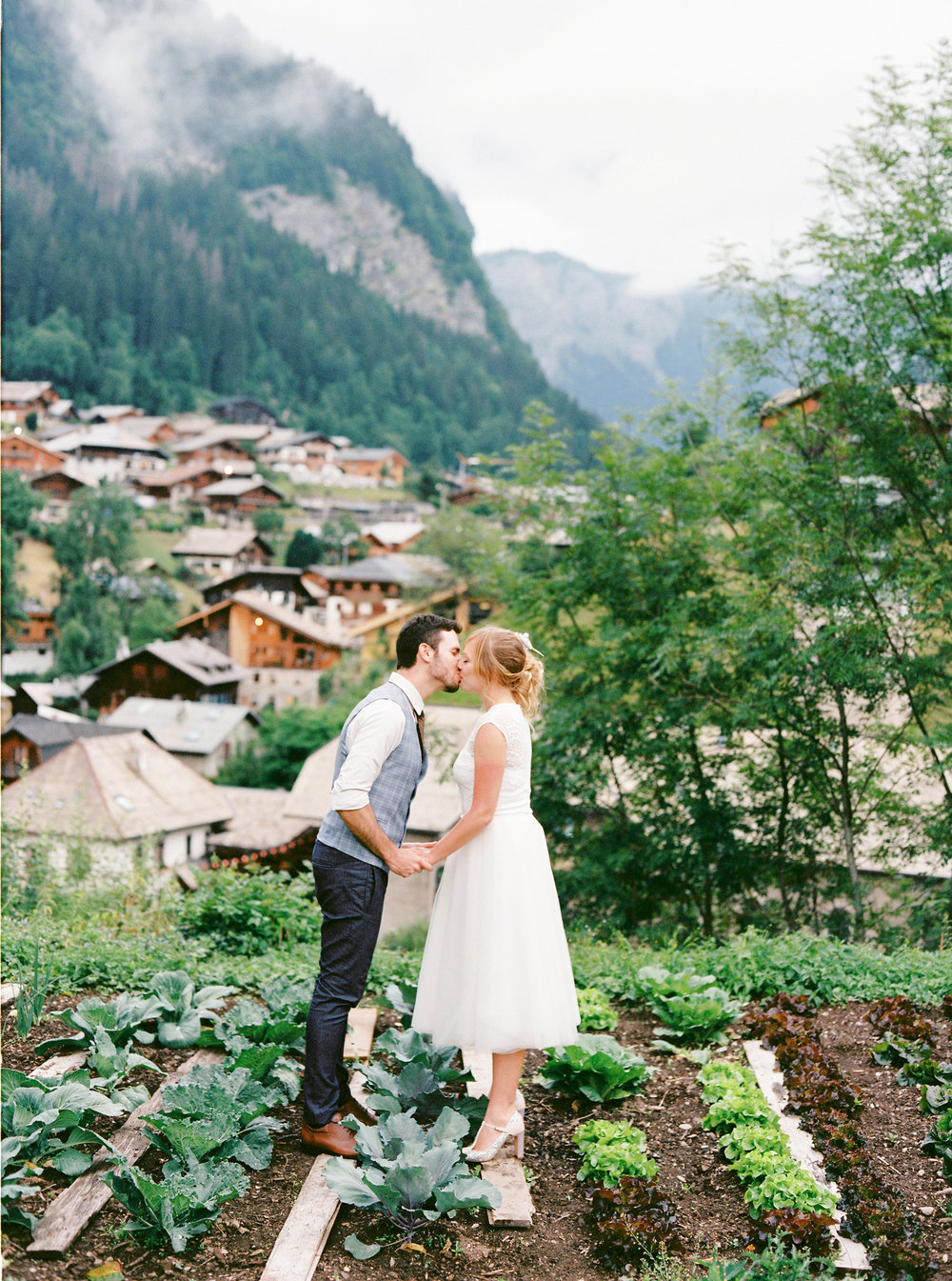 French Alps summer wedding - A beautiful wedding at The Farmhouse in Morzine. Reuben and Polly asked their closest friends and family from all over the globe to join them in this stunning mountain village for their wedding weekend. There was a thunderstorm during the ceremony, which was just perfect. Easy to see the love shine out with this one.