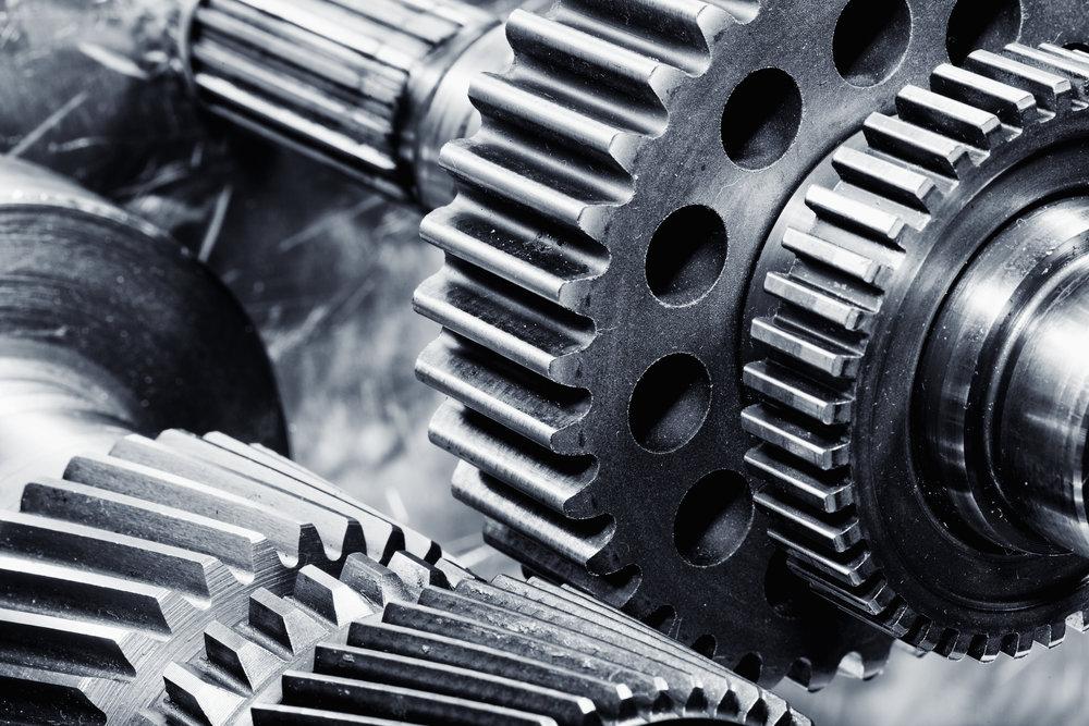 bigstock-gears-and-cogwheels-set-agains-63444658.jpg