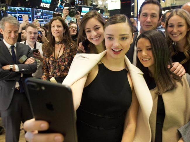 Supermodel Miranda Kerr (and fiancé to Snapchat CEO, Evan Spiegel) taking a selfie with friends at the NYSE opening bell as Snap Inc. celebrates its IPO