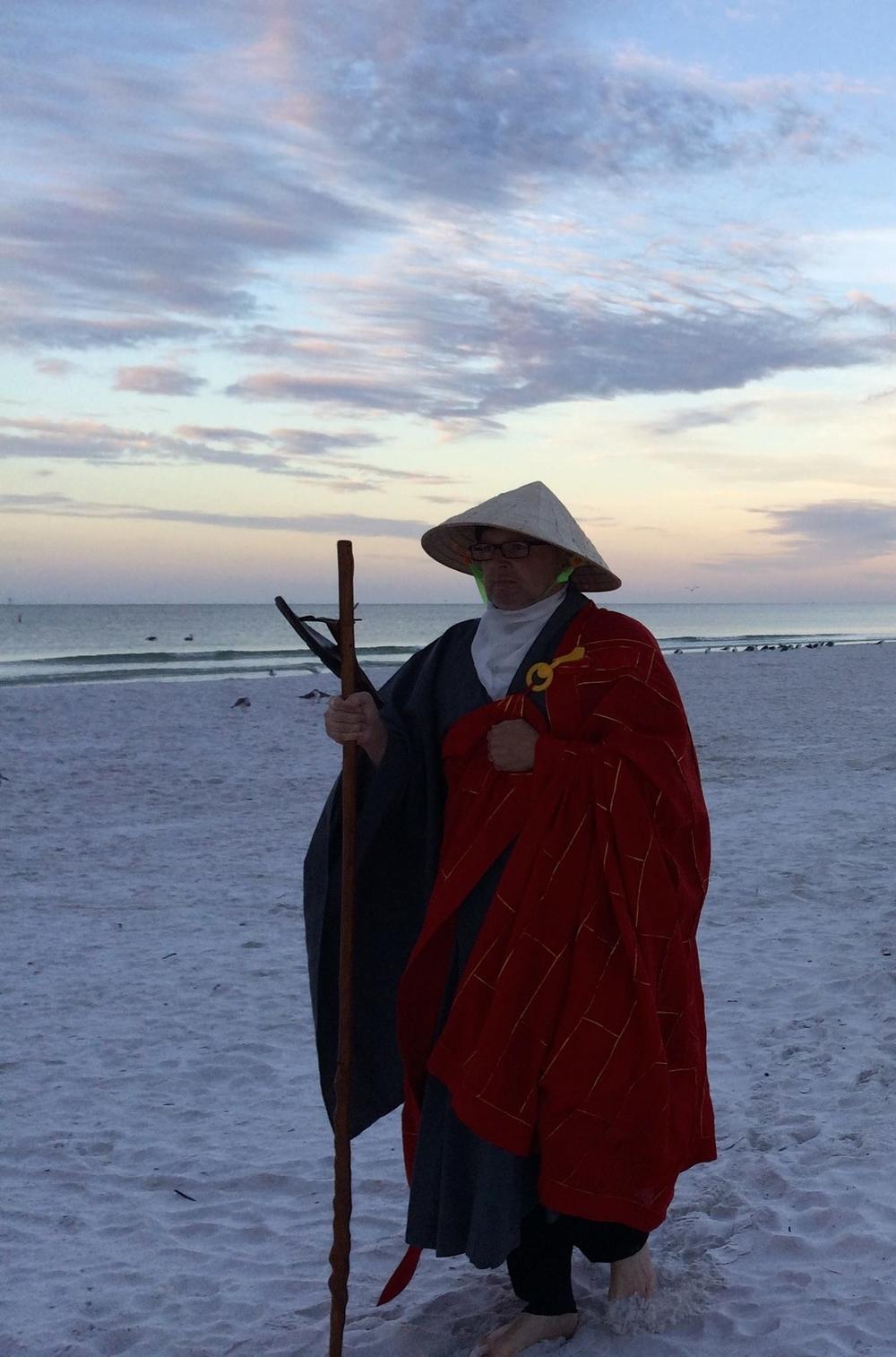 Osho leading kinhin, walking Zen on Siesta Key beach during sunrise meditation.