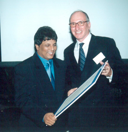 Sri Lankan investigative journalist Lasantha Wickramatunga receiving the 2000 Integrity Awards from Frank Vogl. In January 2009, Lasantha was murdered. It was widely reported as a political assassination in retribution for his years of writing about governmental corruption.