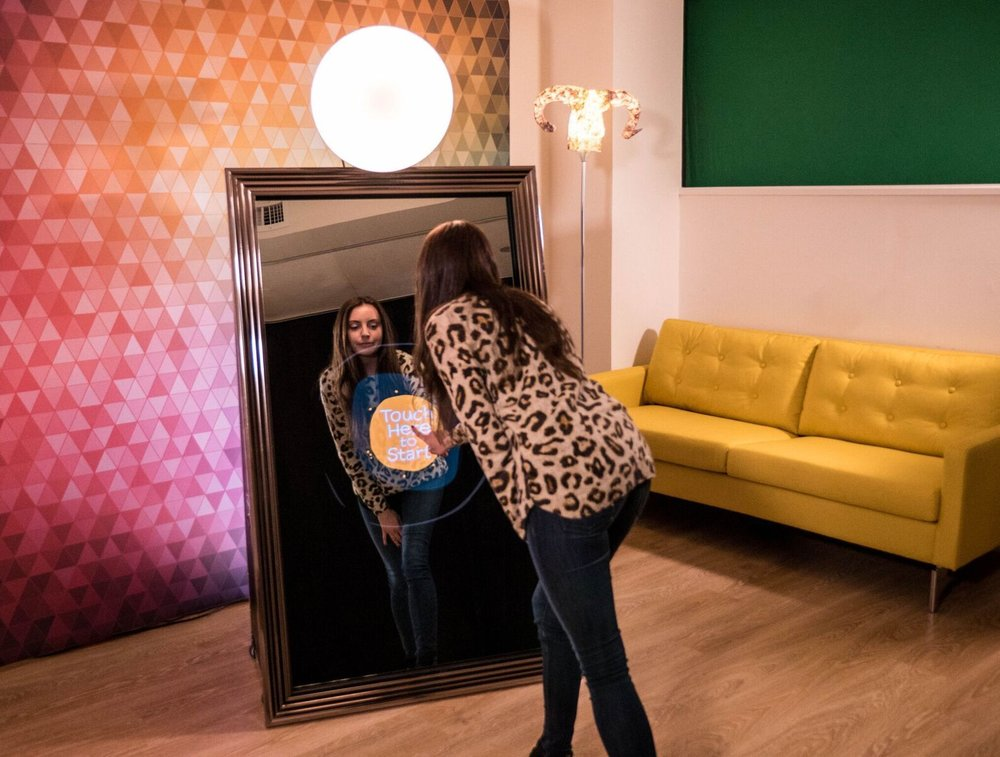 Magic Mirror Booth - The Magic Mirror Booth is a unique photo-generating product offering the latest technology in interactive picture taking. The full-length mirror offers a functional design and a user-friendly interface, communicating with guests through a touch screen of colorful animations and an entertaining voice guidance.