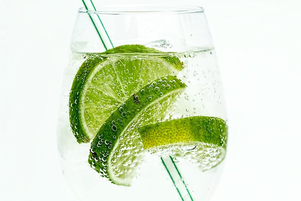 Switch to a soda & fresh lime - refreshing and looks like a G&T ;)