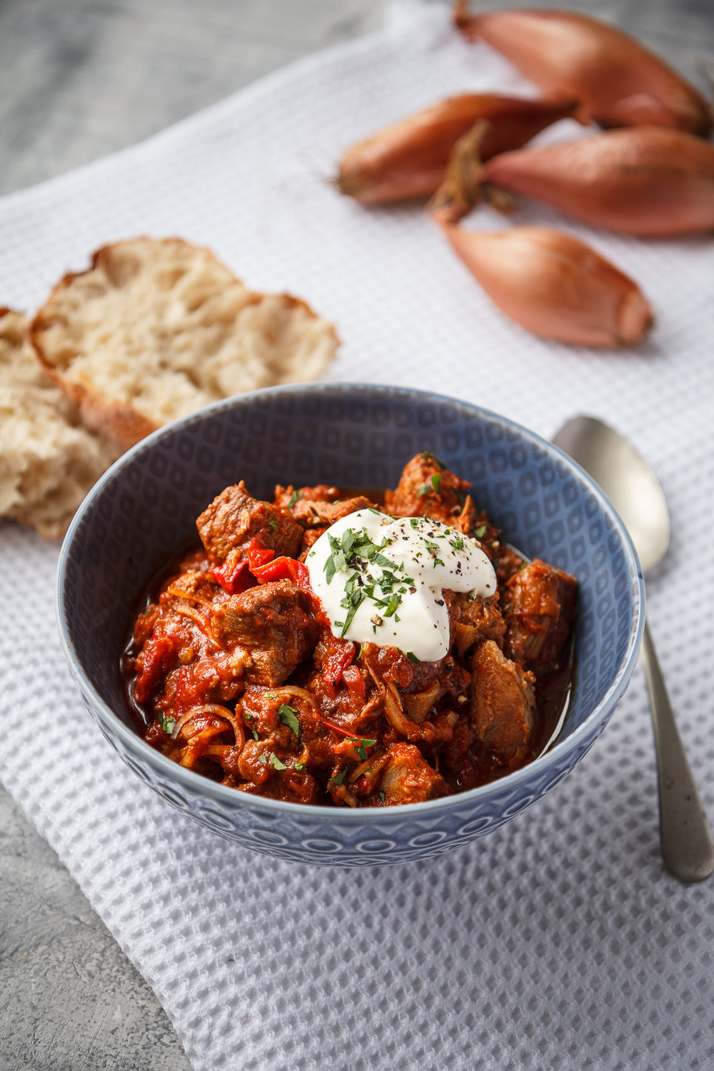 Slow cooker pork, shallot, red pepper goulash - A comforting and hearty Hungarian-inspired slow cooked stew to chase those winter chills away.