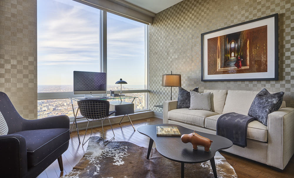 Custom Wallpaper, Knoll Furniture and Hermes Fabrics and Accessories immerse the Study at a Penthouse at 401 North Wabash