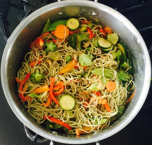 Stir fried veggies tossed with peanut sauce and noodles