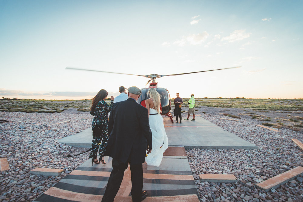 A helicopter waits to whisk away the newlyweds