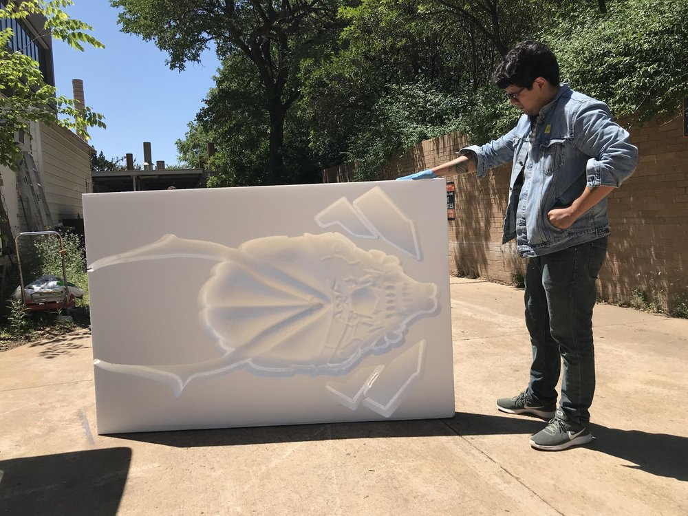 Miguel at The University of Texas at Austin with his finished piece made of styrofoam