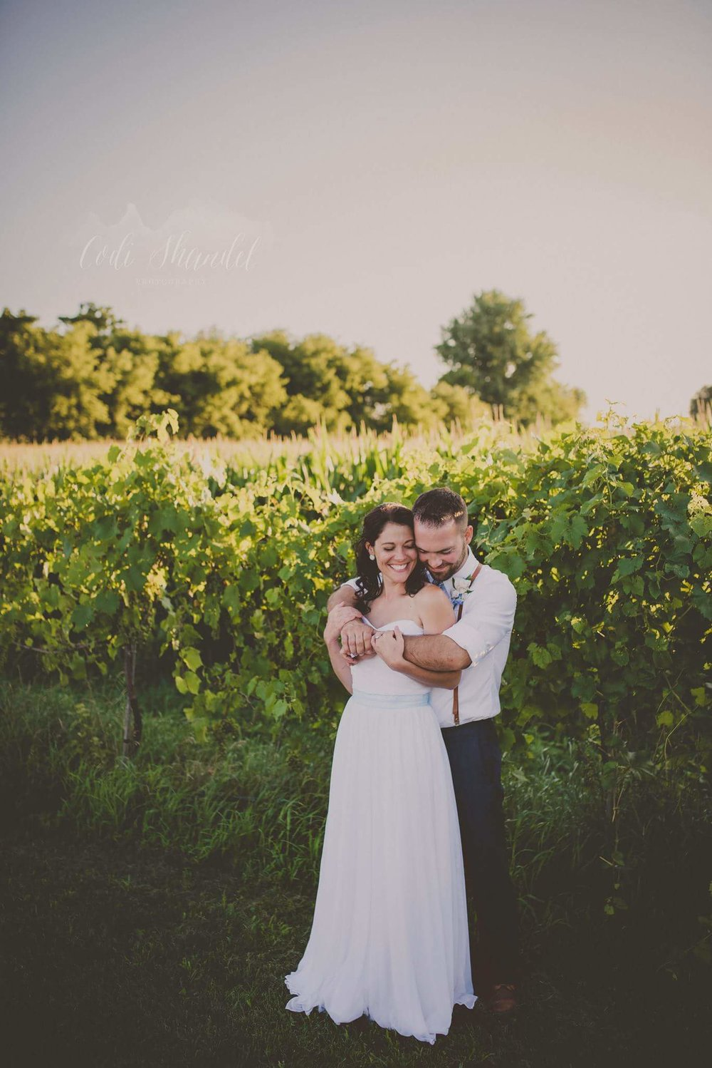 "2.  Codi Shandel Photography  ""Romance at its best! A vineyard, a gorgeous couple, a sweet, private moment...Perfection!"" -Danielle & Emily"