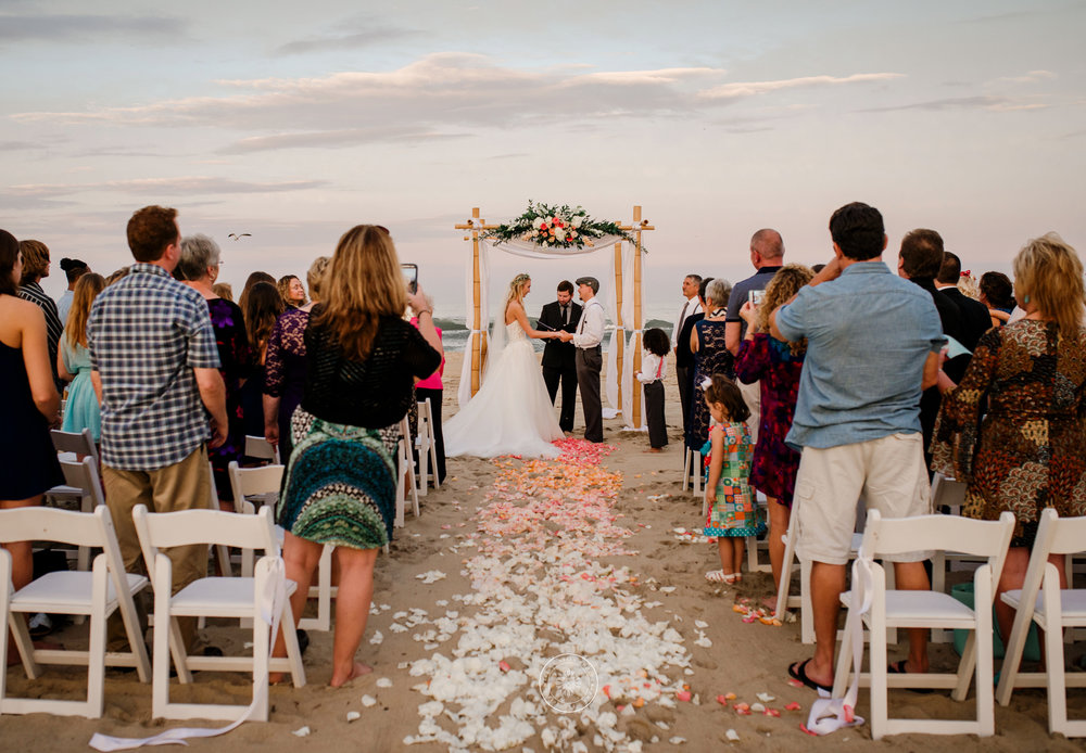 couple-exchange-vows-at-sunset-beach-ceremony-shifting-sands-damneck-virginia-beach-weddings