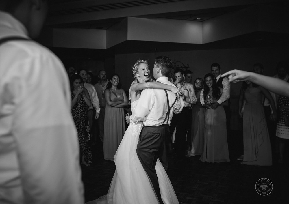 bride-and-groom-dance-shifting-sands-virginia-beach=wedding-reception-va-wedding-photographer
