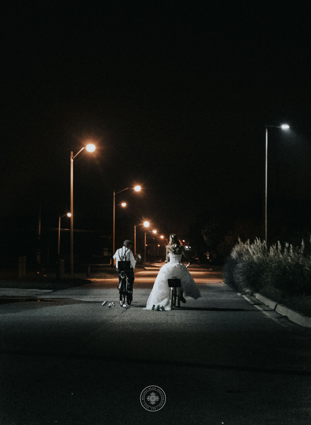 bride-and-groom-exit-wedding-reception-on-bikes-norfolk-wedding-photographer-melissa-bliss-photography