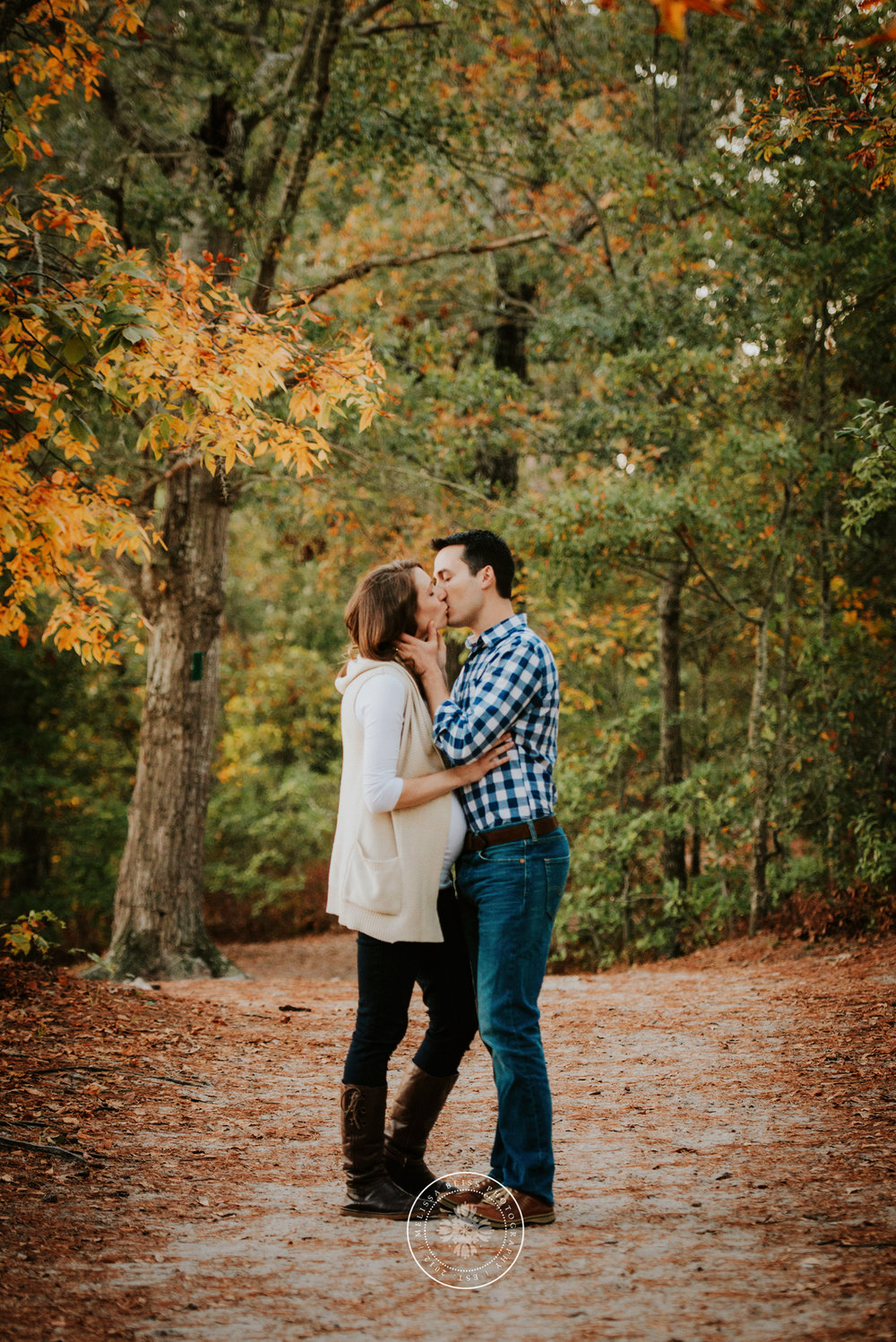 couple-kissing-in-the-fall-woods-norfolk-va-beach-photographer-melissa-bliss-photography