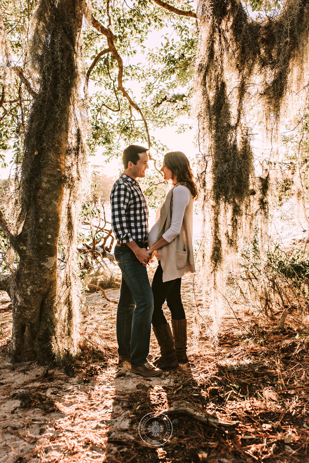 sunlight-streams-through-trees-couples-session-first-landing-state-park-virginia-beach-va-photographer