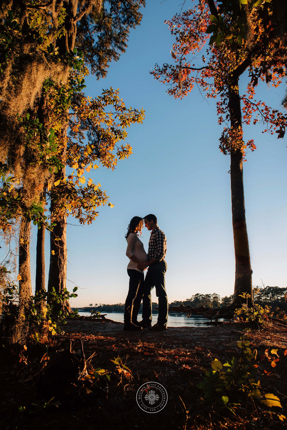 couple-standing-in-trees-first-landing-state-park-maternity-photo-inspiration-norfolk-va-beach