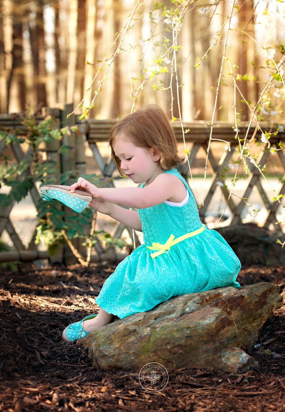 young-girl-green-dress-spring-flowers-golden-light-red-wing-park-child-photography-va-beach