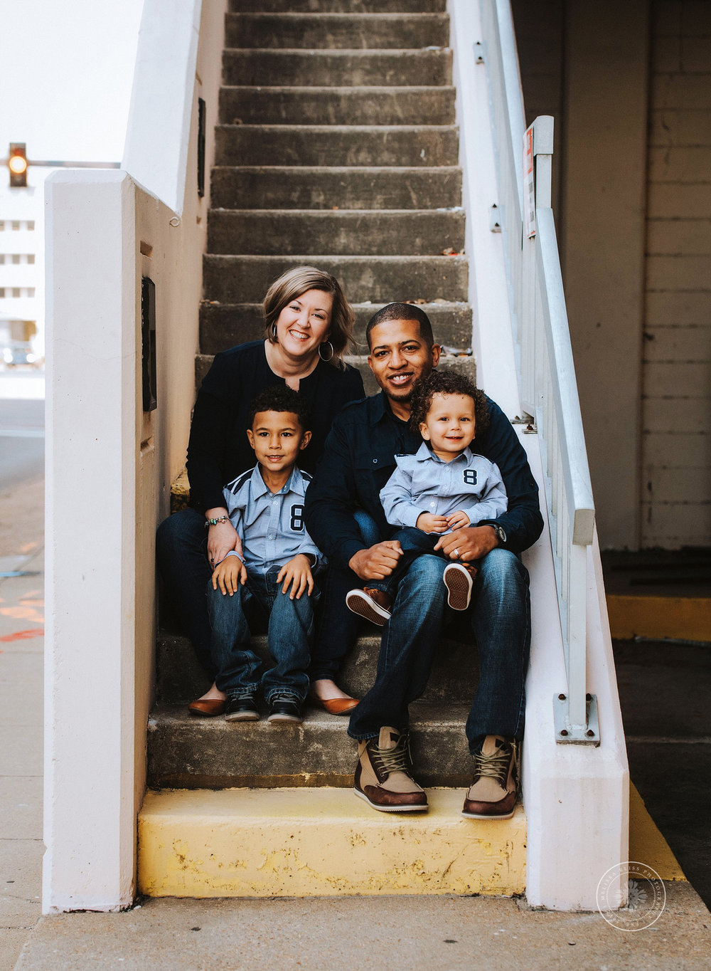 family-of-four-sitting-on-steps-urban-virginia-beach-melissa-bliss-photography