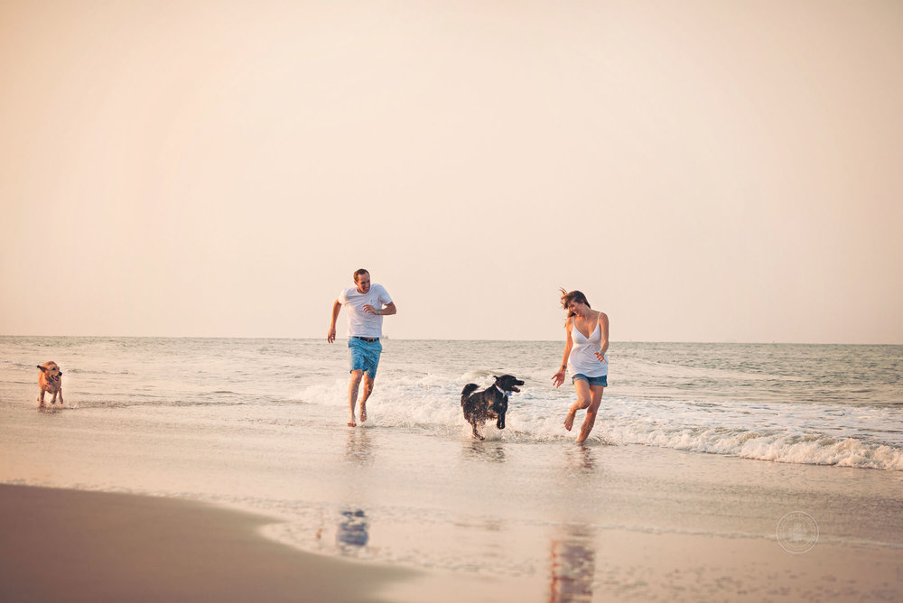 couple-playing-with-dogs-at-sunset-va-beach-photographer-melissa-bliss-photography