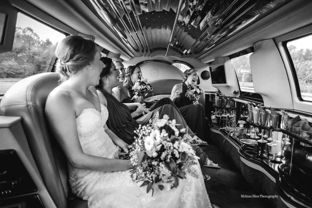 bridal-party-in-limo-womans-club-of-portsmouth-wedding-melissa-bliss-photography-norfolk-wedding-photographers.jpg