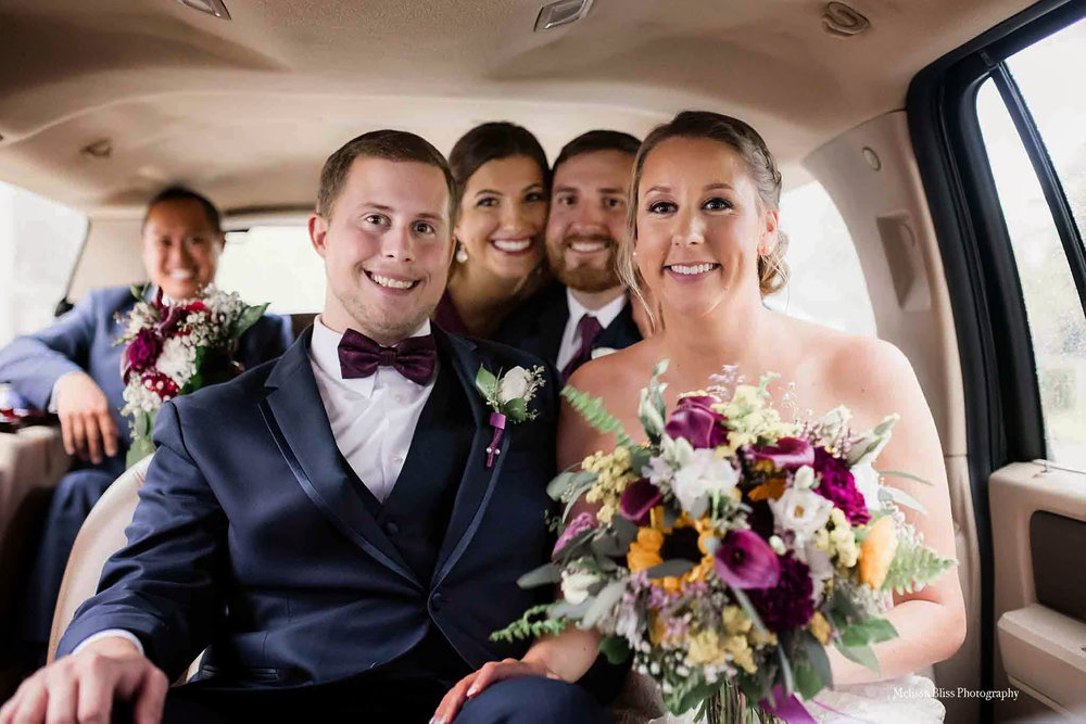 portsmouth-va-wedding-photographer-melissa-bliss-photography-bride-groom-in-limo.jpg