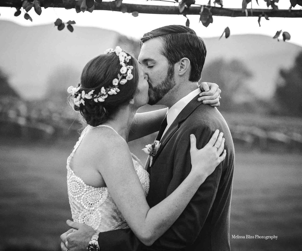 bride-groom-kiss-veritas-vineyard-mountain-winery-wedding-VA-wedding-photographer-melissa-bliss-photography-richmond-norfolk-williamsburg-photographer.jpg