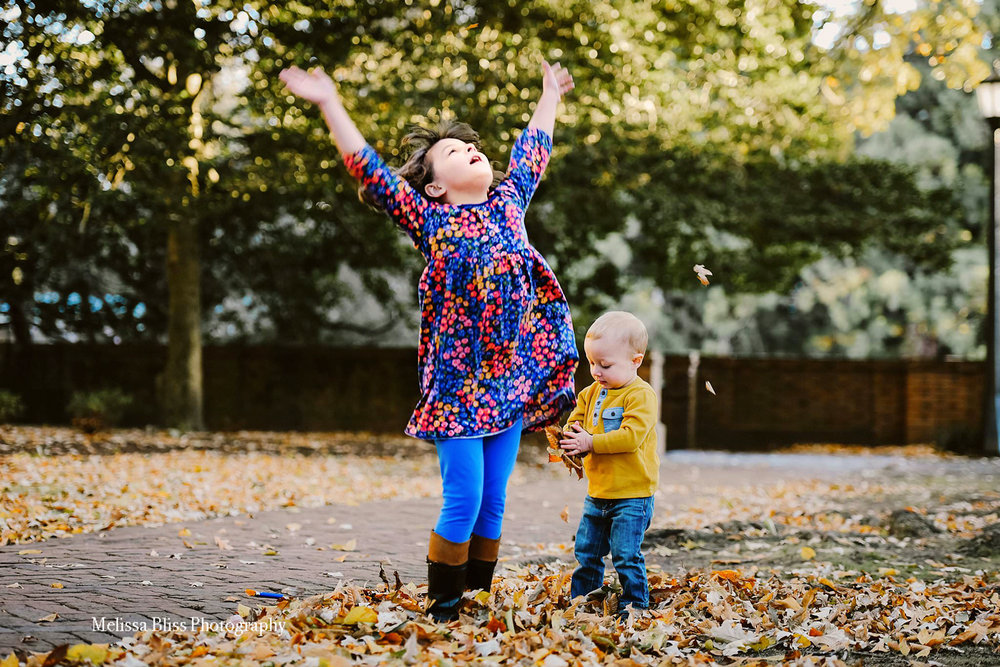 children-play-in-leaves-at-colonial-williamsburg-fall-family-photo-session-by-melissa-bliss-photography.jpg