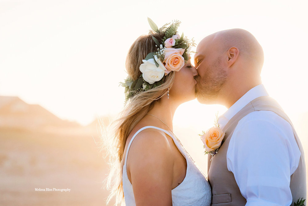 bride-and-groom-kiss-virginia-beach-wedding-by-melissa-bliss-photography-norfolk-sandbridge-va-beach-wedding-photographer.jpg