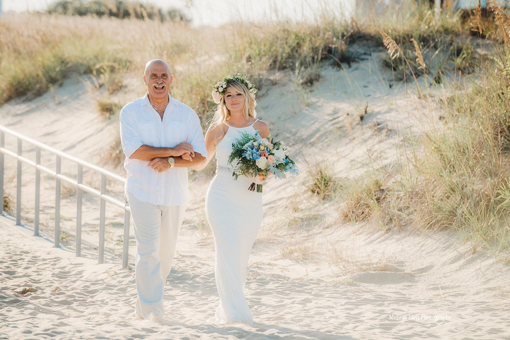 father-walks-bride-down-the-beach-wedding-ceremony-by-virginia-beach-wedding-photographer-melissa-bliss-photography.jpg