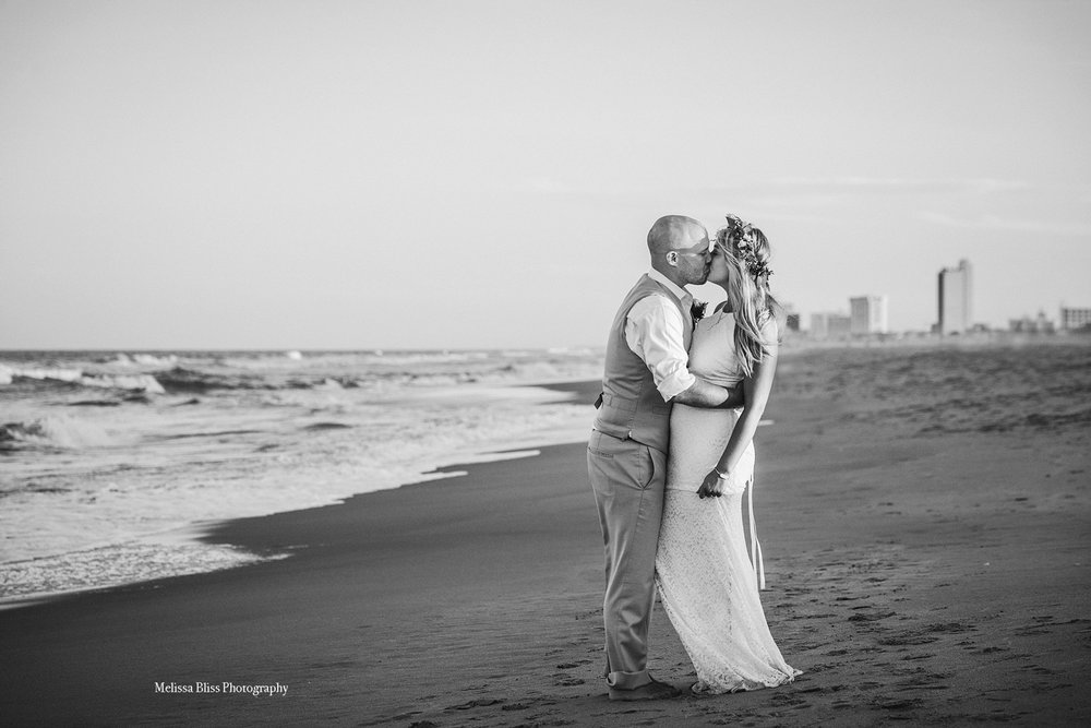 bride-groom-kiss-by-ocean-virginia-beach-elopement-by-melissa-bliss-photography-norfolk-williamsburg-destination-wedding-photographer.jpg
