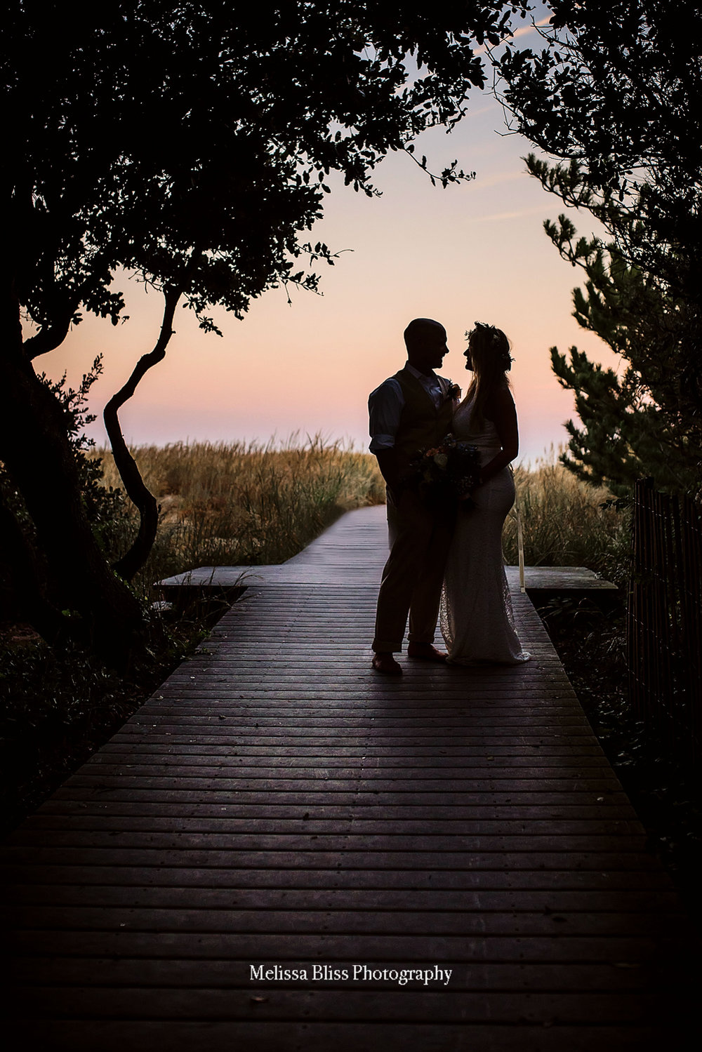 sunset-silhouette-of-bride-and-groom-on-virginia-beach-by-melissa-bliss-photography-va-wedding-photographer.jpg