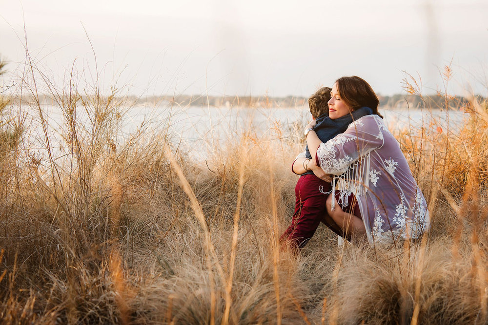 mom-and-little-boy-embrace-by-the-shore-virginia-beach-mom-and-me-sessions-by-melissa-bliss-photography.jpg
