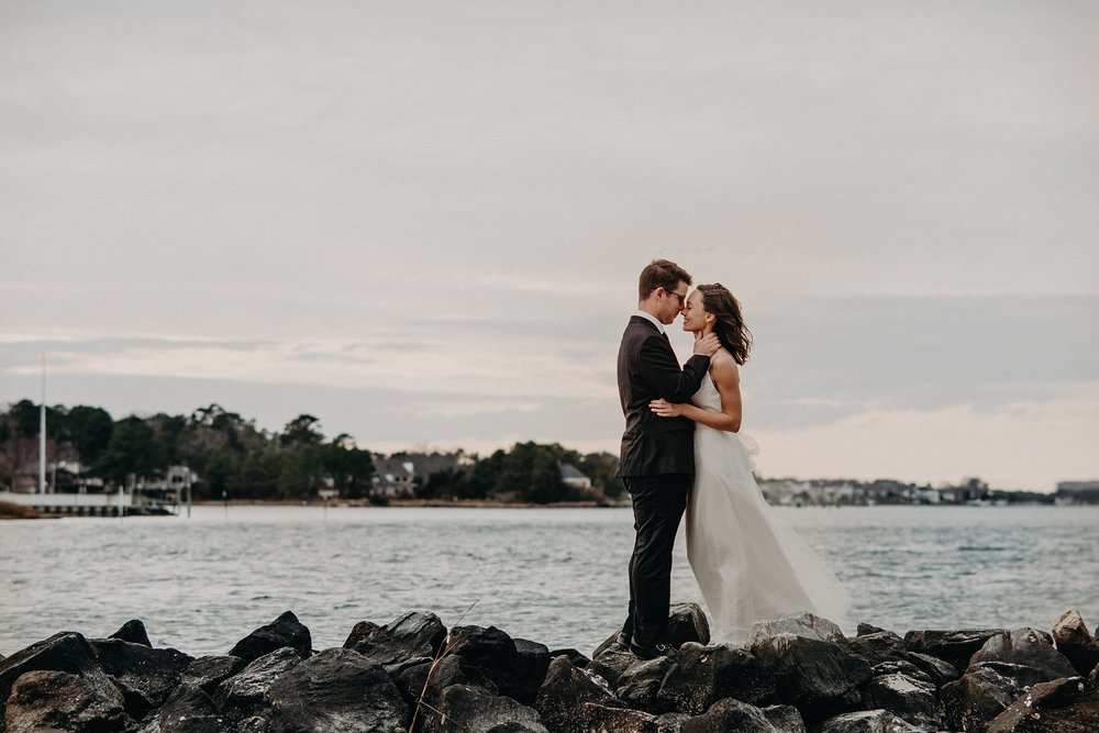 Bride-Groom-on-rocky-shoreline-Norfolk-VA-elopement-photos-melissa-bliss-photography.jpg